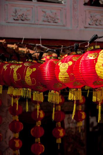 Illuminated lanterns hanging on wall
