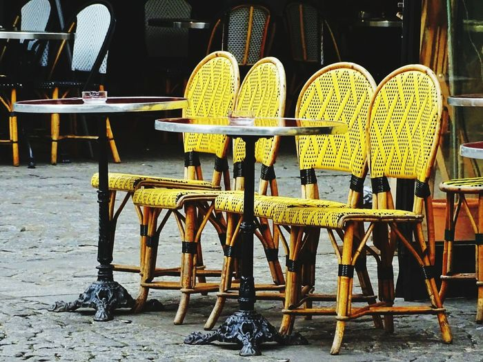Chair No People Outdoors Day Yellow Color Yellow City EyeEm HDR Filter EyeEm HDR ParisianLifestyle Paris Streets Paris, France  Terrasse Au Soleil Terrasse View Terrassedeparis Chair And Table Chairs Outside Pubs EyeEm Yellow Street Photography Streetphoto_color Paint The Town Yellow