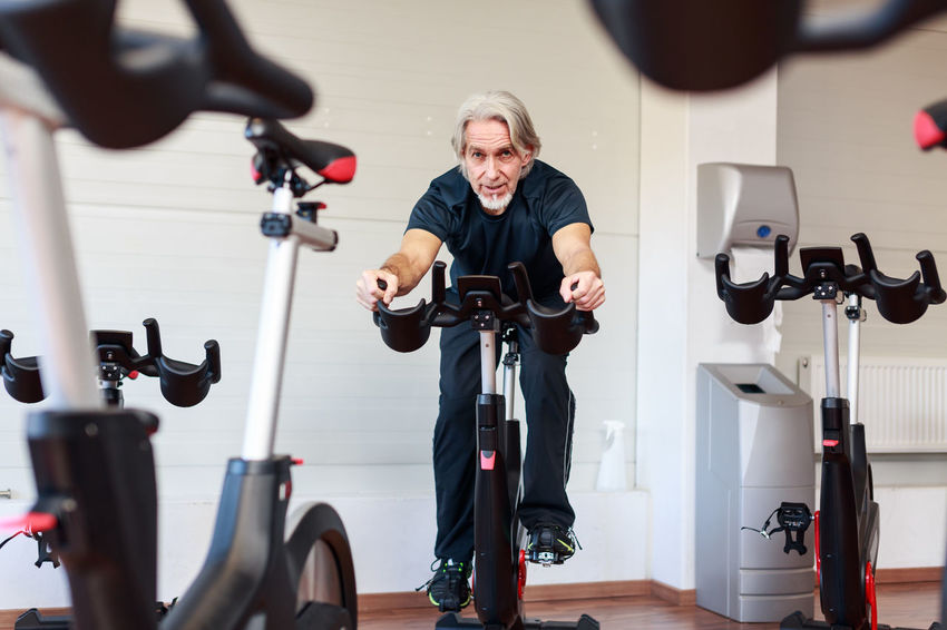 Athlete Exercising Sportsman Activity Bicycle Cycling Exercise Bike Exercise Equipment Exercising Exercising In Nature Fitness Gym Health Club Healthy Healthy Lifestyle Indoors  Leisure Activity Lifestyles Retirement Plan Senior Senior Adult Senior Men Sport Sports Workout
