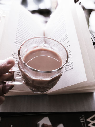 Have a cuppa At Home Chai Latte Ready To Drink Cup Tea And Books Relaxation Cosiness Me Time ♥ Quiet Moments Quality Time Tea Break Homemade Drink Chai Tea Depth Of Field Focus On Foreground Morning Rituals Breakfast Enjoying Life Slow Living Human Body Part Human Hand Holding Human Finger Paper Coffee Cup Food And Drink Refreshment Leisure Activity Coffee - Drink Indoors  Food Stories