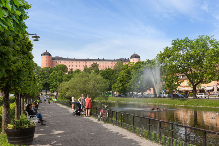 Swan pond against the Uppsala Castle. This pond was built in 1500s and one of the most popular promenades in the center of Uppsala City. Architecture Day Europe Outdoors Park Pond Scandinavia Sky Sweden Tourism Travel Destinations Uppsala Uppsala, Sweden