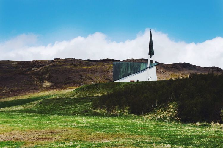 Where Björk doesn't live Explore Nature Green House Church Travel Iceland Sky Architecture Built Structure Building Exterior Cloud - Sky Nature Grass Day Building Land Plant Field Sunlight No People Outdoors Wall - Building Feature Landscape Rural Scene