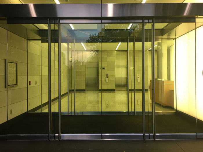 Absence Architectural Column Architectural Feature Architecture Building Built Structure Corridor Day Door Empty Flooring Glass Glass Door Illuminated Interior Modern No People Tile