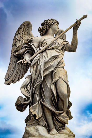 Angel With The Lance Ancient Civilization Angel Angel Bridge Art Bridge Calendar Christianity Church Cultures Italy Ponte San'angelo Religion Rome Sculpture Statue Statue Statues Street Travel Travel Photography Traveling Water