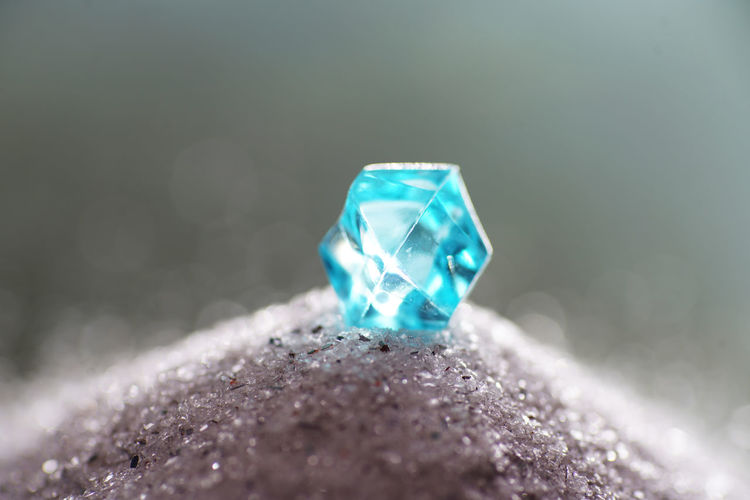 Macro Shot Of Blue Crystal On Stone