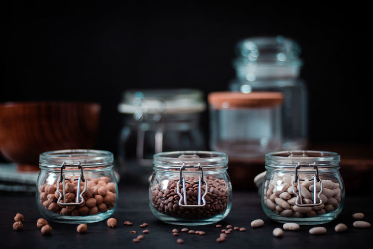Close-up of ice cream in glass jar on table