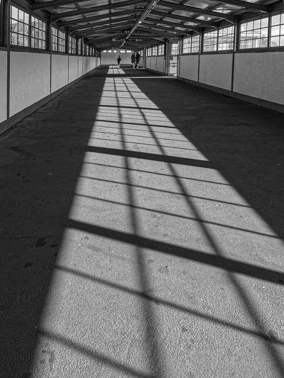 Shadow of people on footpath in building