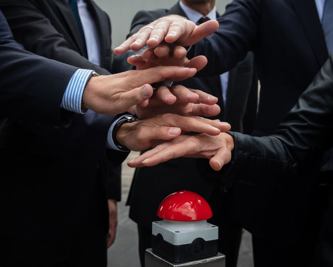 Button Kickoff Red Button Adult Body Part Business Finger Group Group Of People Hand Human Body Part Human Finger Human Hand Indoors  Males  Men Midsection Occupation People Real People Red Start Togetherness Women