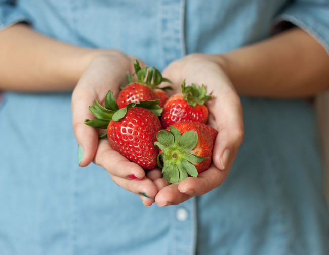 Adult Adults Only Berry Fruit Close-up Day Focus On Foreground Food Food And Drink Freshness Fruit Handful Hands Cupped Healthy Eating Healthy Lifestyle Holding Homegrown Produce Human Body Part Human Hand Juicy Midsection One Person Outdoors People Red Strawberry