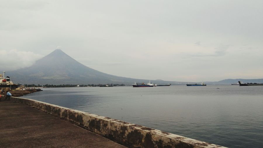 Tranquil Scene Outdoors Tranquility Nature Sea Beauty In Nature Volcano Mayon Volcano Philippines BoulevardPuroLegazpiCityPhilippines Mountain Water Sky Scenics Day Transportation Nautical Vessel Travel Destinations No People Mountain Range