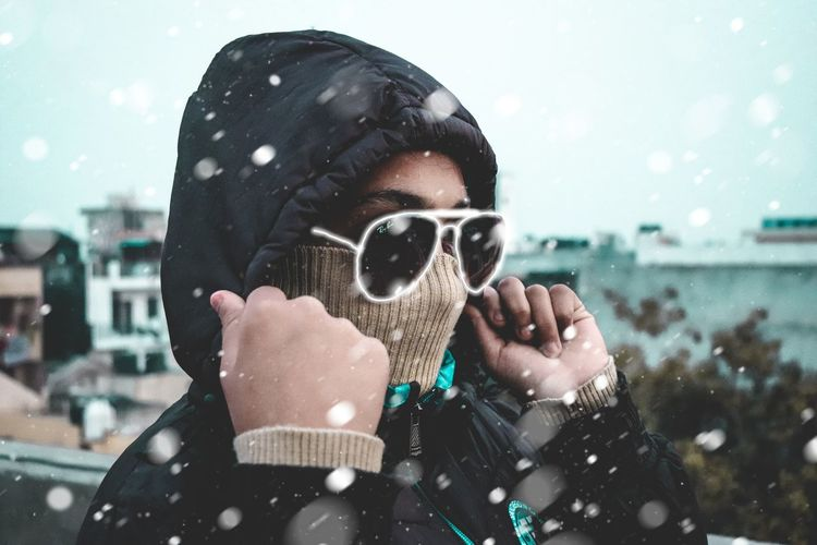 winter's...neon Snow Winter Cold Temperature Fashion Aviator EyeEmNewHere EyeEm Best Shots EyeEm EyeEm Selects My Best Photo Snow Snow ❄ Winter Breeze Men Headshot Water Close-up Sky Hooded Shirt Hooligan Sweatshirt Gas Mask Mask