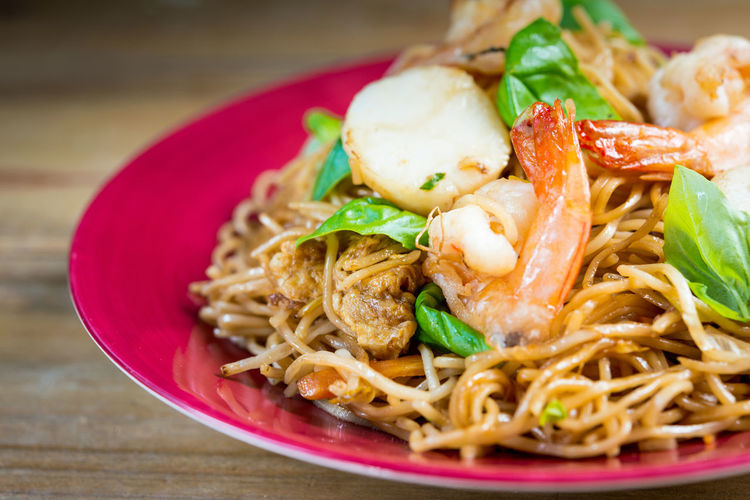 Close-up of noodles with seafood and vegetables on table