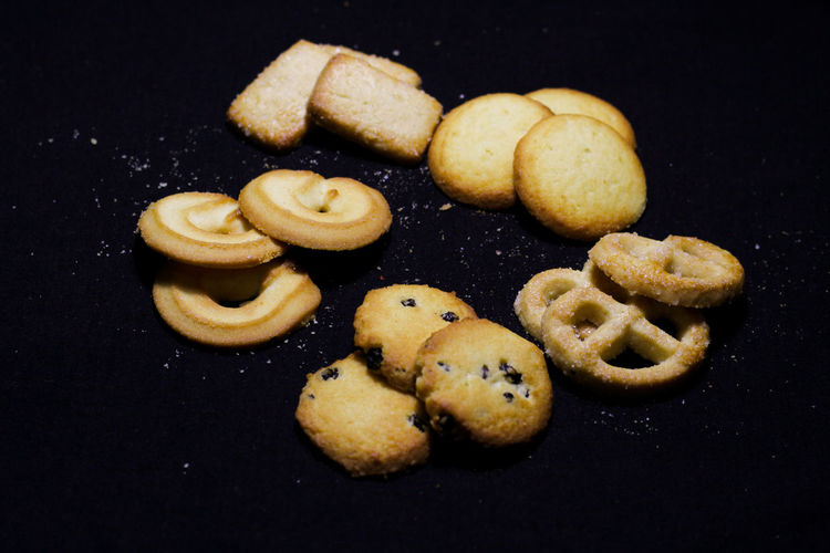 Close-up of cookies against black background