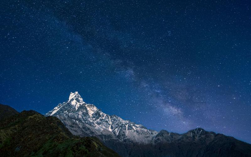 Beautiful night view of mountain fishtail and milky way, pokhara, nepal.