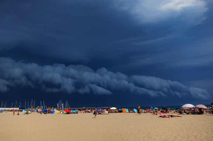 Storm clouds gathering across the plage Storm Clouds Gathering Beach Cloud - Sky People Plage Sand Sky Storm Cloud