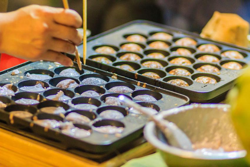 Vendor is cooking for Khanom khrok or coconut-rice pancakes, one of the ancient Thai desserts. Khanom Khanom Thai Coconut-rice Pancake Khanom Khrok Khanomkhrok Khanomthai