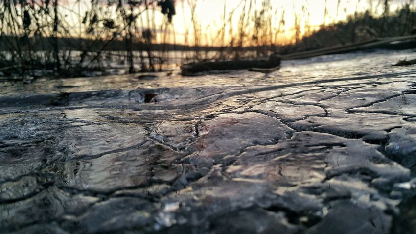 Ice Reflection Nature Sunset Water No People Reflection Cracked Outdoors Beauty In Nature Close-up Sky Shades Of Winter