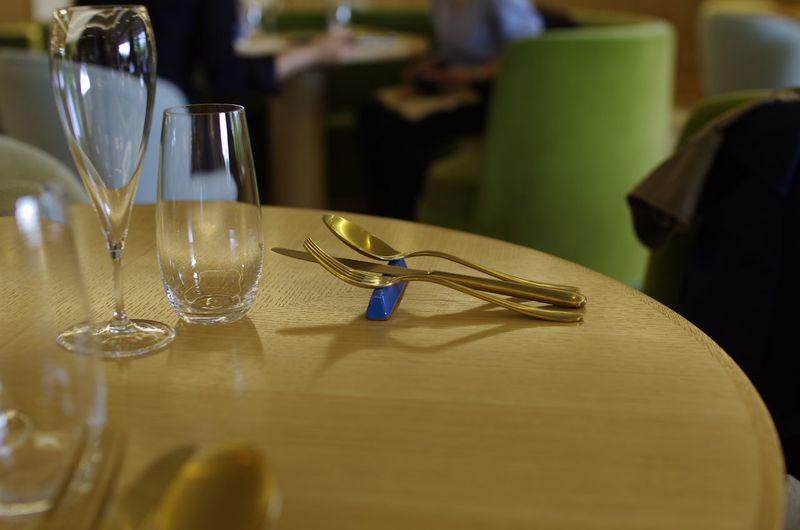 Glasses and eating utensils on restaurant table