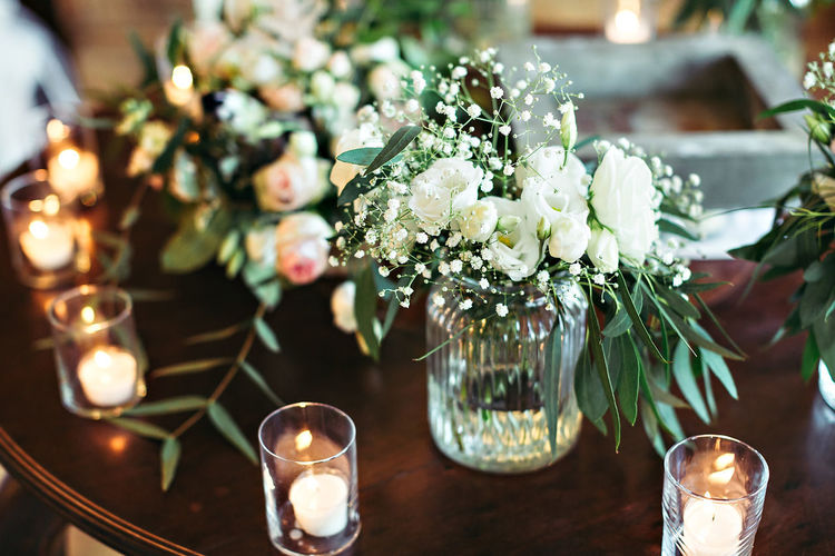 Beauty In Nature Bouquet Candle Celebration Close-up Day Flower Flower Head Focus On Foreground Fragility Freshness Illuminated Indoors  Nature No People Table Tea Light Vase