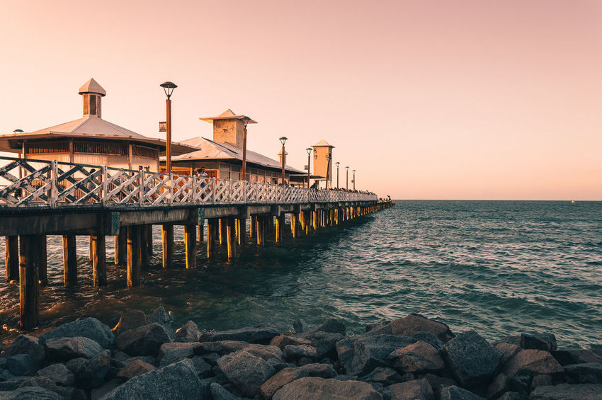 Architecture Beach Beauty In Nature Building Exterior Built Structure Clear Sky Day Horizon Over Water Nature No People Outdoors Pier Scenics Sea Sky Sunset Tranquil Scene Tranquility Water