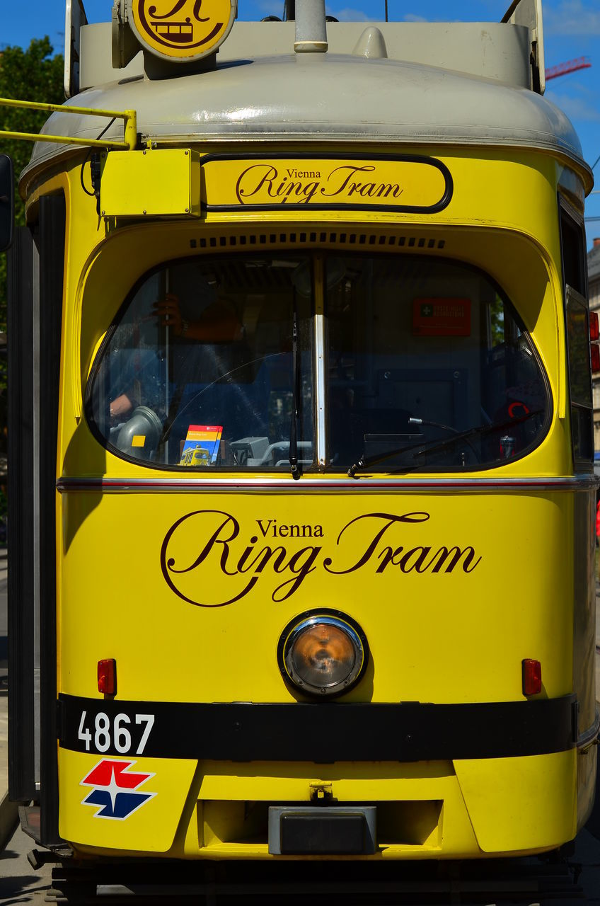 text, western script, communication, yellow, bus, day, outdoors, no people, close-up