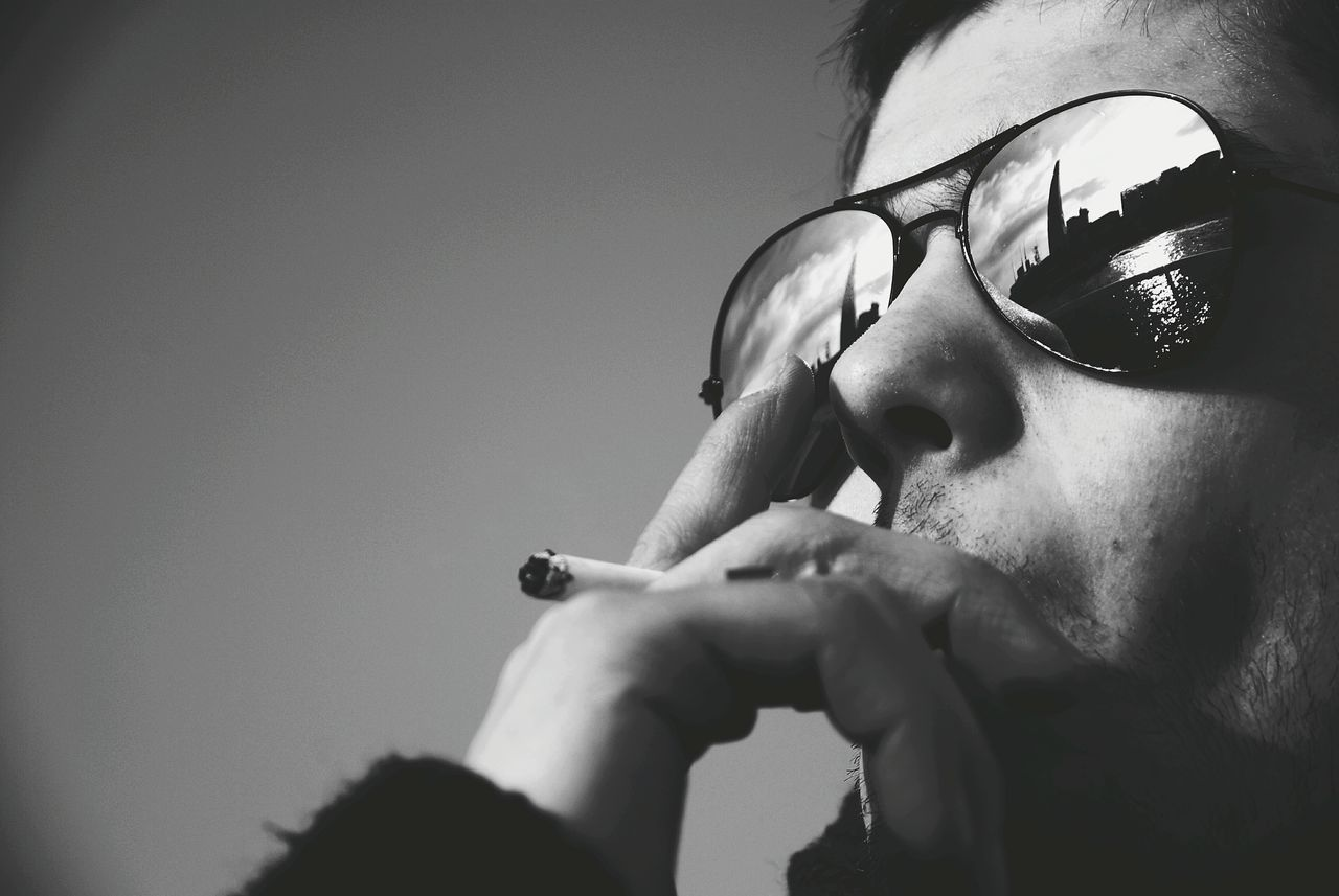 Close-Up Of Young Man Smoking Cigarette