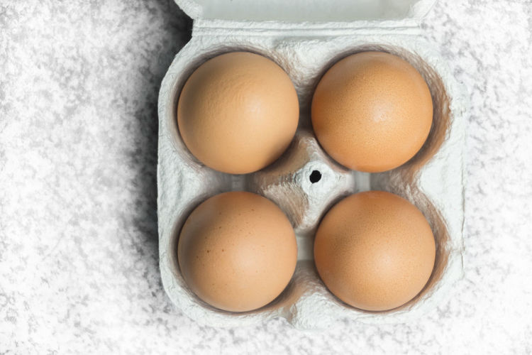 Diet Diet & Fitness Animal Egg Brown Close-up Day Diet Food Directly Above Easter Egg Egg Carton Egg Yolk Eggshell Food Food And Drink Fragility Freshness Healthy Eating High Angle View Indoors  No People Protein Raw Food White Background