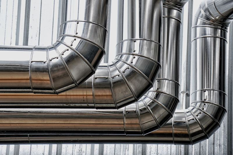 Chilled Work Hot Water Pipe Finishing Work Covering Aluminum Insulation Indoors  No People Metal Pattern Day Backgrounds Close-up Industry Silver Colored Design Pipe - Tube Factory