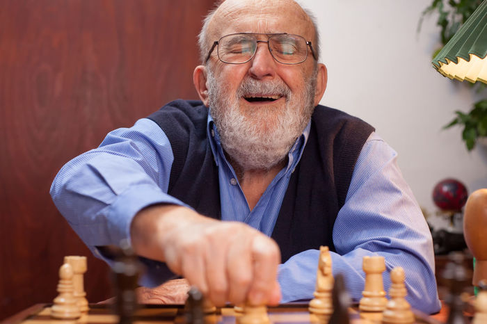 old man winning chess match Happy Man Winning Beard Checkmate Chess Chess Board Competition Concentration Eyeglasses  Front View Indoors  Intelligence Leisure Games Lifestyles Move Old Pensioner Player Playing Satisfied  Senior Adult Smiling Strategy Table