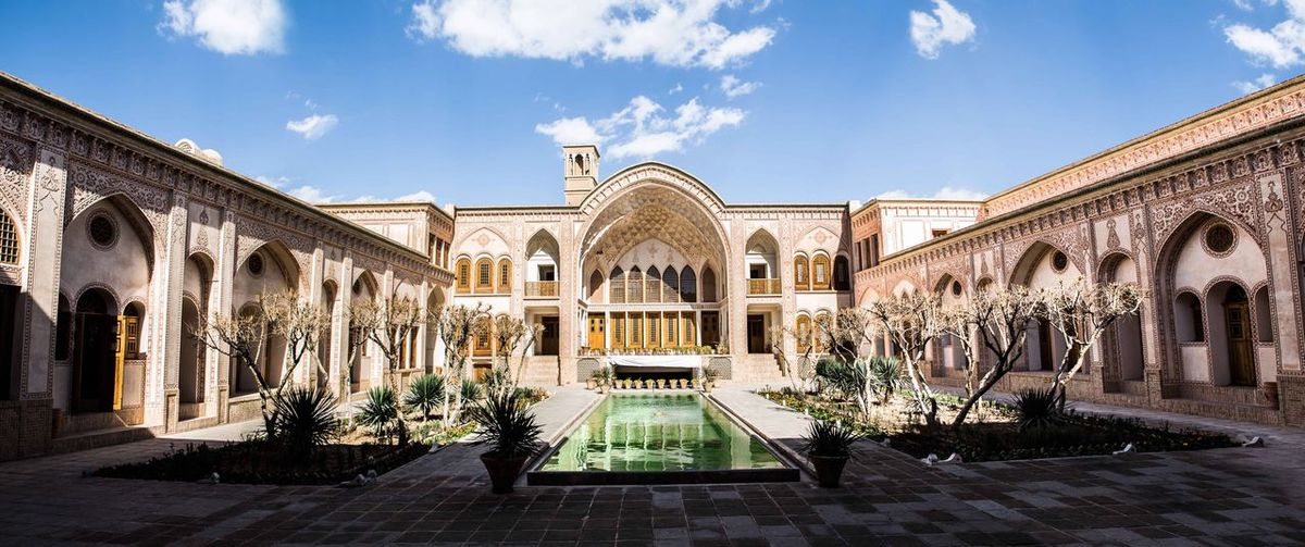 Ameri house is a historic house in Kashan,Iran. It was built during the Zand era for Āghā 'Āmeri, the governor of Kashan, who was responsible for maintaining the security of the route between Tehran and Kerman. Covering an area of 9,000 square metres (97,000 sq ft), it includes seven courtyards. The house is one of several large spectacular old houses in the central district of Kashan. Like the other houses around it, it was rebuilt in the 19th century, after the city was ravaged by a series of massive earthquakes in the 18th century Iranian Art Iranian Art Iran Kashan Historical Place Historical Building History Ameri EyeEm Selects Architecture Arch Sky Cloud - Sky Built Structure Architectural Column Building Exterior No People History Outdoors Day Colour Your Horizn EyeEmNewHere Go Higher Stories From The City The Architect - 2018 EyeEm Awards The Architect - 2019 EyeEm Awards