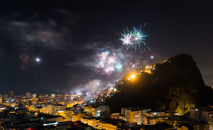 City Life Community Copacabana Dark Dramatic Sky Dusk Favela Fireworks Human Settlement Illuminated Lens Flare Moody Sky Night No People Orange Color Outdoors Outline Residential District Rio De Janeiro Silhouette Sky Sun Sunset Urban