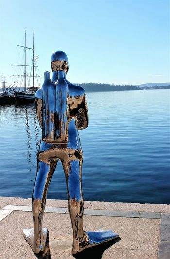 Statue Water Front View Sea Oslofjord Oslohavn Outdoors Horizon Over Water Clear Sky Blue Day Sea View Sea_collection Eyem Gallery Seascape Photography Travel Destinations Shiny Reflection Reflection_collection Urban Art