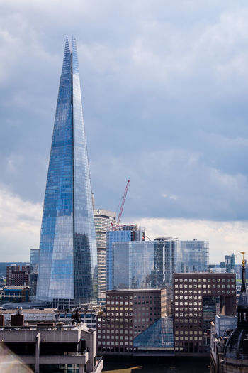 Architecture Built Structure Building Exterior Sky City Cloud - Sky Office Building Exterior Building Tall - High Tower Office Skyscraper Nature Travel Destinations Cityscape Day No People Modern Outdoors Spire  Financial District  The Shard Blue Glass - Material Reflection Office London Capital Cities  Crain Crane