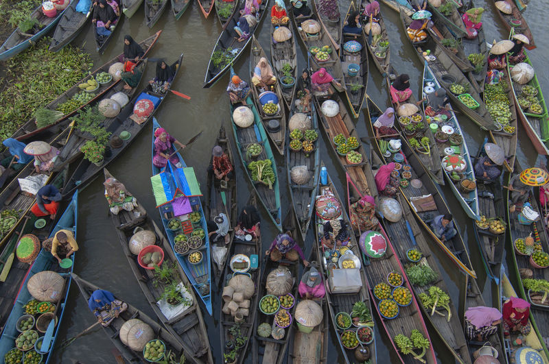 High angle view of people at street market