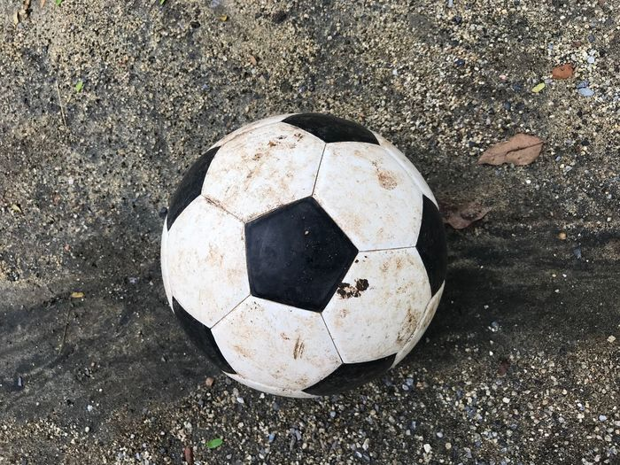 Dirty soccer ball Sport Soccer High Angle View Soccer Ball Team Sport Ball No People Sports Equipment Day Football Land Directly Above Outdoors Beach Sunlight Road Sand Nature Close-up Still Life