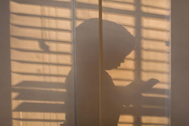 Shadow of hand on window