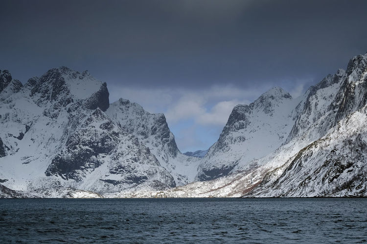 Stormy clouds over Reine Village, Lofoten Archipelago, Norway, Europe Scenics - Nature Beauty In Nature Mountain Sky Cold Temperature Nature Snowcapped Mountain Lofoten Lofoten Islands Lofoten Norway Lofoten Landscape Lofoten And Vesteral Islands Landscape Landscape_Collection Landscape_photography Travel Travel Destinations Travel Photography Travelling Winter Wintertime Winter Wonderland Winter Cold Day Reine Reine In Lofoten Reine Fjord Reine Fiord Sea Seascape Seascape Photography Cloudy Cloudy Day Cloudy Sky Stormy Weather Stormy Sky Stormy Sea