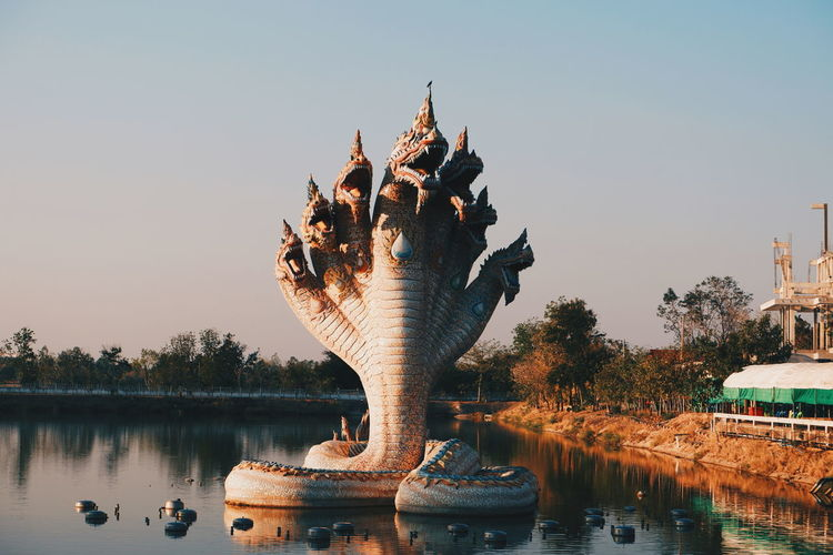 Water Representation Sky Art And Craft Sculpture Statue Architecture Nature Creativity Lake Built Structure Travel Destinations Waterfront Human Representation No People Clear Sky