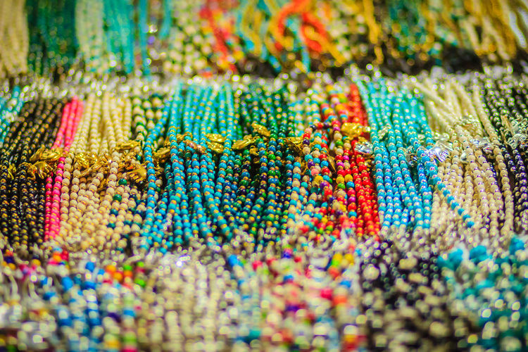 Colorful bracelets, beads and necklaces souvenir for sale on street at Khao San Road night market, Bangkok, Thailand. Bracelets Khao San Rd Khao San Road KhaoSan Khaosan Rd. Khaosandroad Necklaces Tourist Tourist Attraction  Tourists Abundance Backgrounds Choice Close-up Food Food And Drink Full Frame Indoors  Khao San Khao San Knok Wua Khao San Rd. Khaosan Road Khaosanroad Large Group Of Objects Multi Colored Night Market Night Market In Thailand Night Market, No People Pattern Retail  Selective Focus Sweet Sweet Food Textile Tourist Destination Variation Vibrant Color