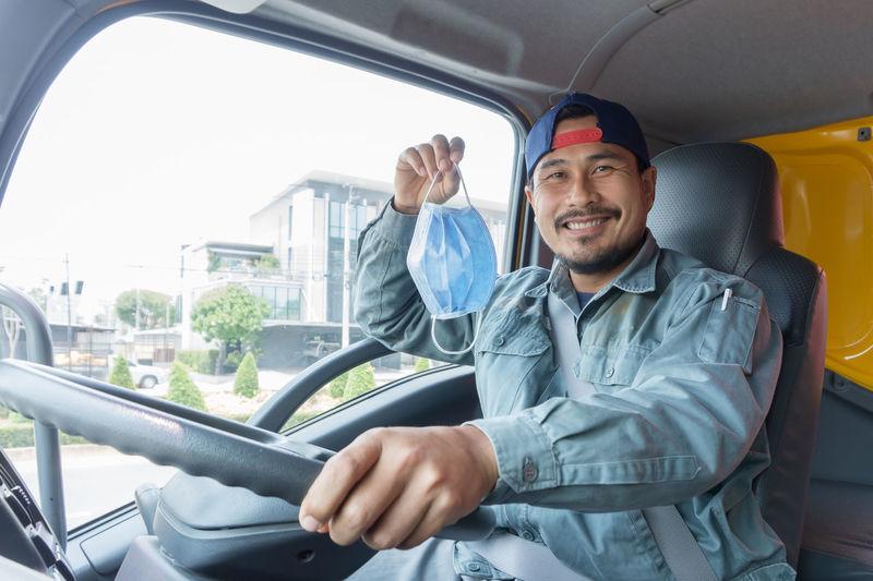 Man smiling while sitting in car