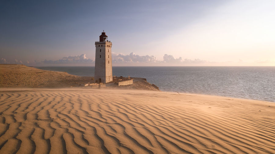 Denmark Sunset_collection Architecture Beach Beauty In Nature Building Exterior Built Structure Cliff Day Direction Guidance Lighthouse Nature No People Outdoors Sand Sand Dune Sandy Sea Sky Sunset Travel Destinations Water Waves