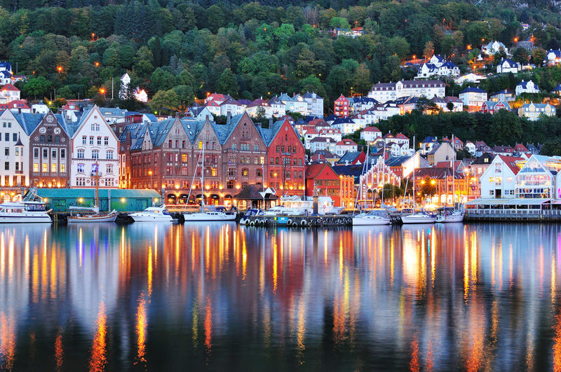 Reflection of Bergen, Norway. Amusement Park Architecture Bergen Celebration City Cityscape Colorful Harbor Illuminated Nautical Vessel Night No People Norway Outdoors Reflection River Sky Skyline Transportation Travel Destinations Tree Urban Water Waterfront