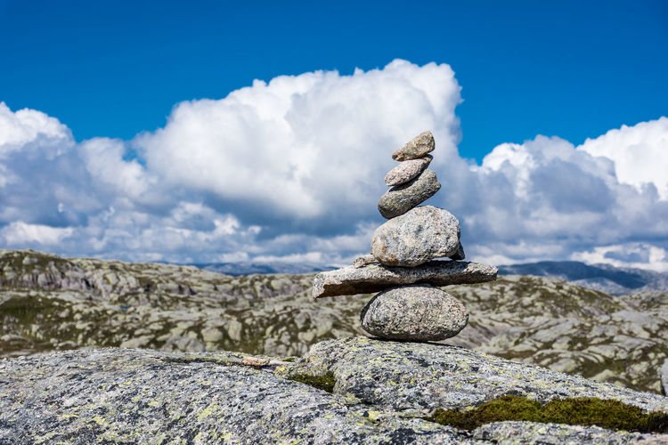 Stack of stones against sky