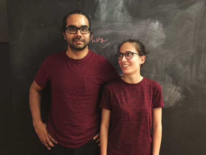 Portrait Of Smiling Couple Against Wall
