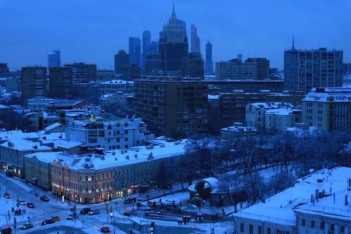 Moscow skyline in the evening Architecture Building Exterior Winter Snow Built Structure Cityscape City Cold Temperature Urban Skyline Skyscraper Night Outdoors Sky Residential Building No People Tree Illuminated Travel Destinations Modern Nature