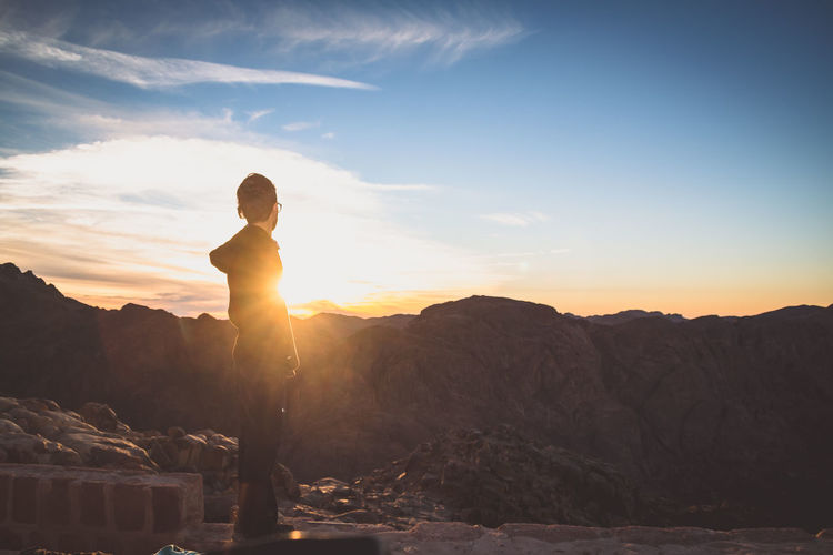 Hiking Sunset Mt.Sinai Sky Beauty In Nature Real People Standing Scenics - Nature Sunlight Mountain Leisure Activity Lifestyles Non-urban Scene Tranquil Scene Nature Lens Flare Cloud - Sky Looking At View One Person Tranquility Full Length Sun It's About The Journey Moments Of Happiness