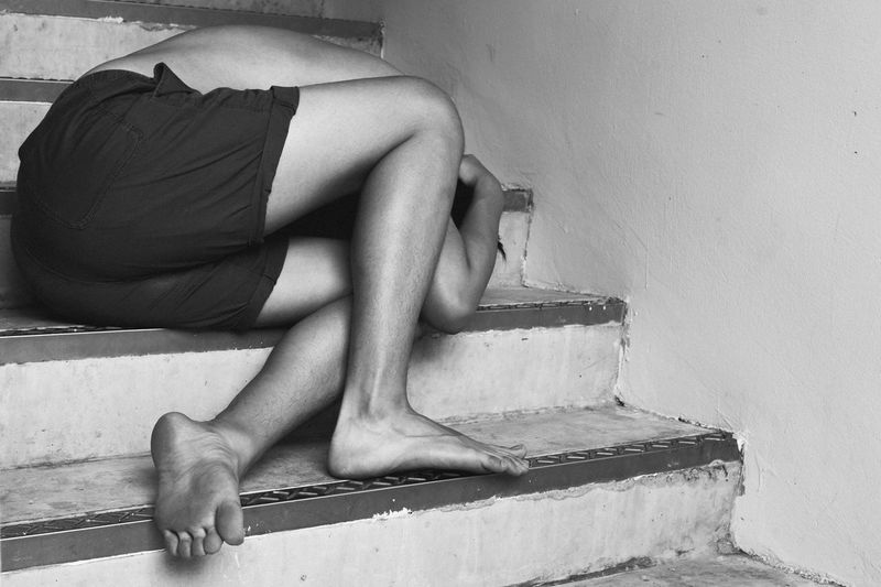 Low section of woman sitting on steps