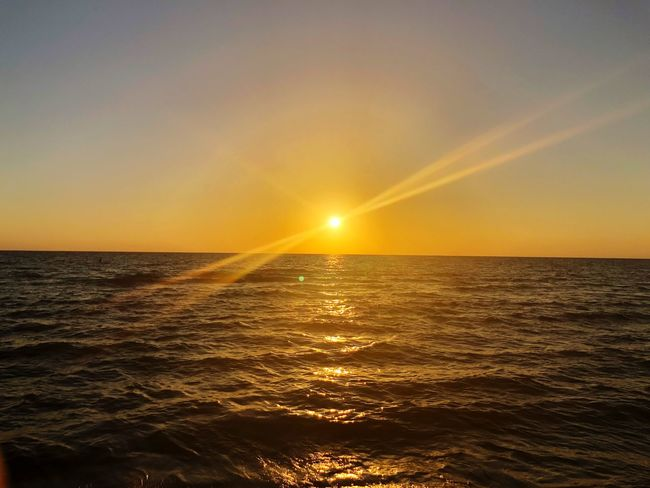 Perfect! The sun, water and me. Sunset Sea Sun Scenics Beauty In Nature Water Nature Horizon Over Water Tranquil Scene Sunbeam Rippled Sunlight Waterfront Tranquility Lens Flare Reflection Idyllic Orange Color Outdoors Sky