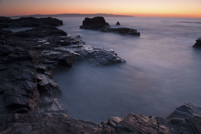 View Of Coastline At Sunset