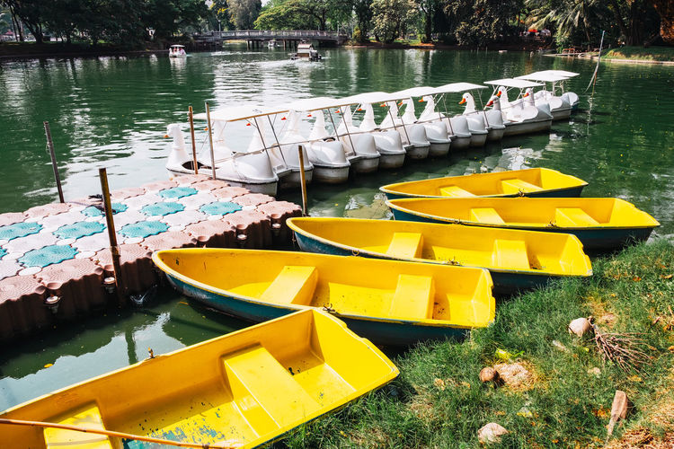 High angle view of yellow moored floating on lake